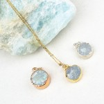 Aquamarine round pendant in rose gold